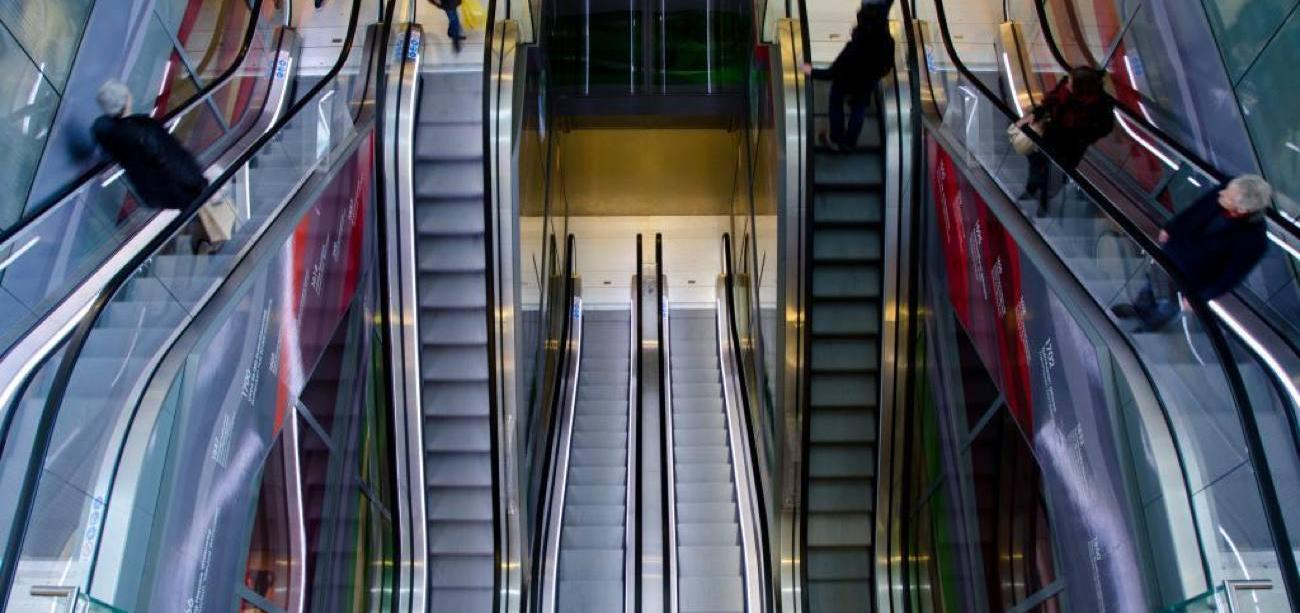 escalators in shopping mall Marvellous digital marketing agency