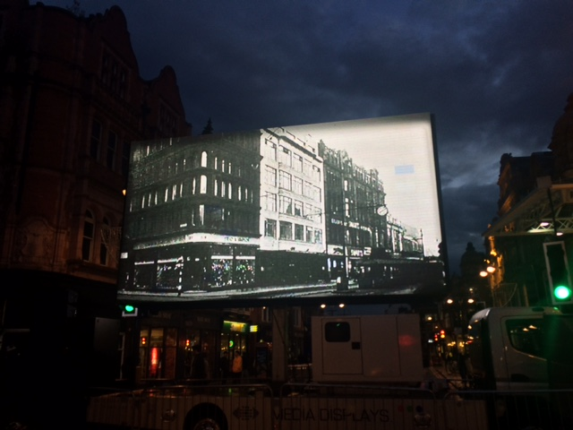 Image on big screen of old Leeds