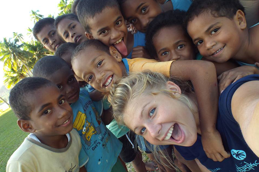 Photo of a volunteer with Fijian children